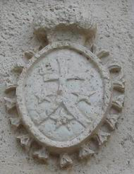 Symbol of the Carmelite order on the wall of the church.